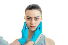 Horizontal portrait of a young girl on the serious doctor with blue mittens Stock Photography