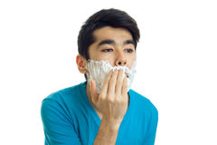 Horizontal portrait of a young man with black hair who smear shaving foam face Royalty Free Stock Image
