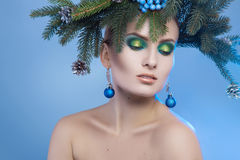 Horizontal portrait of young pretty woman with xmas tree-wreath Royalty Free Stock Images