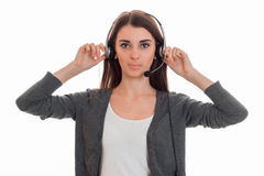 Horizontal portrait of young serious call office worker girl with headphones and microphone isolated on white background Stock Image