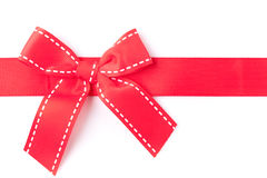 Horizontal red gift ribbon closeup. Red gift ribbon close up on white background Royalty Free Stock Photo