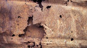 Red rusty metal with holes. Horizontal Red rusty metal with holes Stock Photography