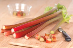 Horizontal of Rhubarb Stalks and Pieces on Wood Counter Stock Photos