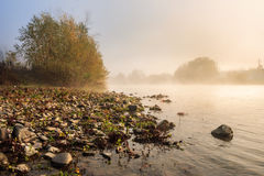 Horizontal river pebble beach in Foggy morning Stock Photos