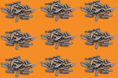Horizontal rows of heaps of different interchangeable heads or bits for manual screwdriver for woodworking and metalworking on ora. Nge background. Seamless royalty free stock images