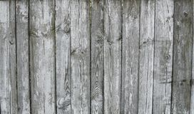 Horizontal rustic weathered old painted wood background with knots and nail holes. Woods texture. stock photography