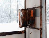 Horizontal rusty cyberpunk public call-box Royalty Free Stock Photography