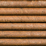 Horizontal rusty pipe background seamlessly tileable Stock Photos