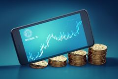 Horizontal sartphone with Bitcoin surge chart on-screen laying on growing piles of golden Bitcoins. Royalty Free Stock Photo