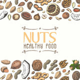 Horizontal seamless background with colored nuts and seeds Royalty Free Stock Images
