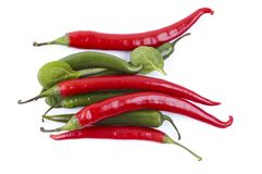 A horizontal series of green and red chili peppers Royalty Free Stock Images