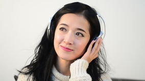 Horizontal shot of Asian woman teenager listing love music with big Headphone stock video