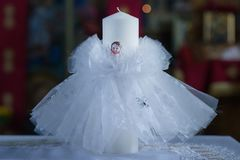 Baptismal candle in an Orthodox church in preparation for the baptism royalty free stock photos