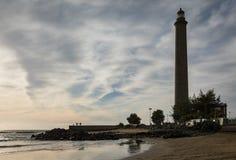 The beautiful beach in Maspalomas, with Faro de Maspalomas or Maspalomas lighthouse, in the background, Gran Canaria royalty free stock photo