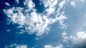 Blue Sky and puffy white & black clouds royalty free stock photo