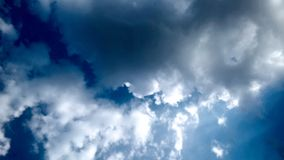 Blue Sky and puffy white & black clouds Stock Photography