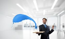 Inspiration of young creative businessman royalty free stock photography