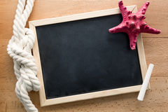 Horizontal shot of clean blackboard decorated by marine knot Stock Photography
