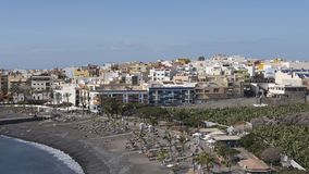Horizontal shot of corner beach at Playa de San Juan, Tenerife, Canary Islands, Spain. Vantage views towards the town and the small beach of black sand, lapilli Stock Image