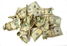 Crumpled Cash Money in a Pile. Horizontal shot of a crumbled pile of twenty dollar bills on a white background Royalty Free Stock Image