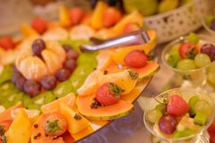 Fruit self-serve display with a large assortment of seasonal and tropical fruit royalty free stock image