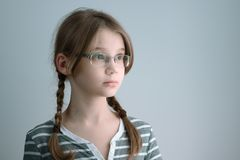 Horizontal shot of a Girl teenager with glasses and two braids. Portrait of the blonde girl Stock Photos