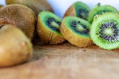 Horizontal shot of knife cutting kiwi fruits royalty free stock photo