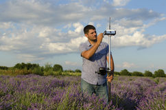Horizontal shot of land surveying work. In a lavender field royalty free stock photography