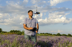 Horizontal shot of land surveyor in a lavender field. Tracing during the day stock images