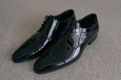 Classic, cap toe Oxford men shoes, in patent leather. Horizontal shot of male footwear for back tie and white tie evening wear or for day-to-day suits and Royalty Free Stock Photos