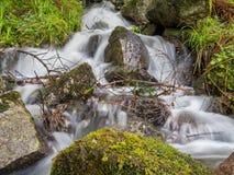Horizontal shot of a messy waterfall Stock Image