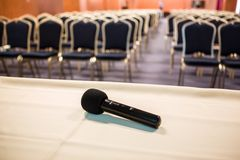 Horizontal shot of microphone and auditorium Royalty Free Stock Photo