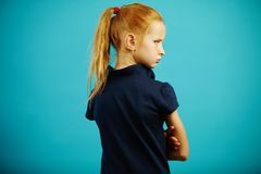 Horizontal shot of offended child, turned away from camera, stands with his back, turns around and gets angry. Malicious. Girl with bad mood has difficult royalty free stock photography