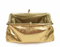 Opened Gold Metallic Coin Purse Focus On Back Closure. Horizontal shot of an open empty gold metallic coin purse on a white background. The focus is on the back Royalty Free Stock Photography