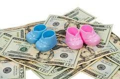 Blue and Pink Plastic Baby Booties Sitting on a Pile of Twenty D. A horizontal shot of a pair of Blue and Pink Plastic Baby Booties Sitting on a Pile of Twenty Stock Photography