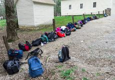 Horizontal Shot of a Row of Backpacks in the Smoky Mountains Nat. Horizontal Shot of a Row of Backpacks leanin against a fence in the Smoky Mountains National Stock Photo