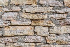 Horizontal shot of texture of a stone wall, old stones close-up Royalty Free Stock Photography
