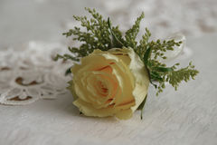 Fresh yellow rose small bouquet for buttonhole, or boutonniere. Horizontal shot of traditional wedding accessory, a little floral arrangement, used for groom and Stock Image