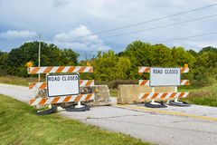 Beaten Up Road Closed Signs royalty free stock photography