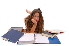 Burnt Out From Too Much Studying Isolated On White. Horizontal shot of a young female teenager showing frustration and just being tired of was too much studying Royalty Free Stock Image