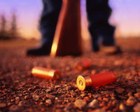 Horizontal shotgun shells on ground Stock Photography