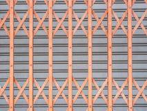 Horizontal Shutter Door. Orange and gray Horizontal Shutter Door stock image
