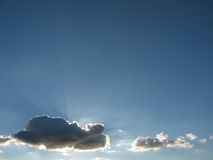 Horizontal Shy Sun. The shy sun is hiding behind the clouds royalty free stock images