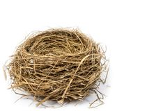 Empty Nest With Copy Space. Horizontal side view of an empty bird`s nest in the lower left hand corner of the shot.  White background.  Copy space Stock Images