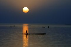 Horizontal silhouette of canoes on Niger River Royalty Free Stock Photo