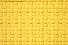 Horizontal square pattern. Yellow wall texture with small squares Stock Images