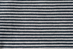 Horizontal stripes black grey. Close up of thin horizontal stripes black and grey, material cotton jersey Stock Images