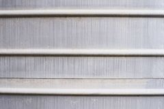 Horizontal stripes on the wall. Metallic gray color Stock Images
