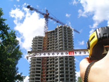 Horizontal tape measure and a newly erected building. Stock Image