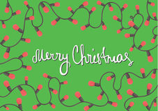 Horizontal template Christmas card. Garland with red lamp on the green background Stock Images